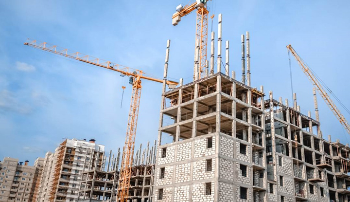 Hoisting cranes and construction of new houses