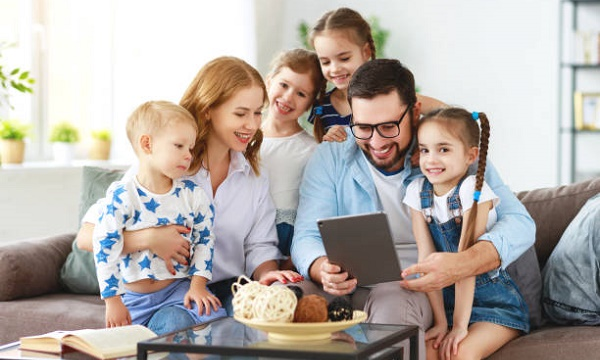 large family mother, father and four children with tablet computer at home